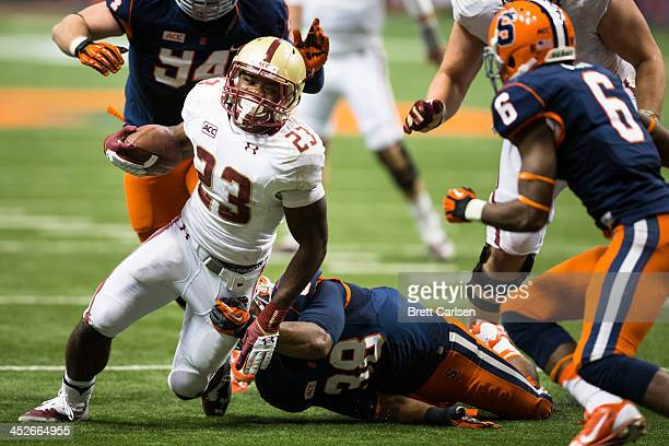 Myles Willis of the Boston College Eagles is brought down by Cameron Lynch of the Syracuse Orange just shy of the goal line in the fourth quarter on...