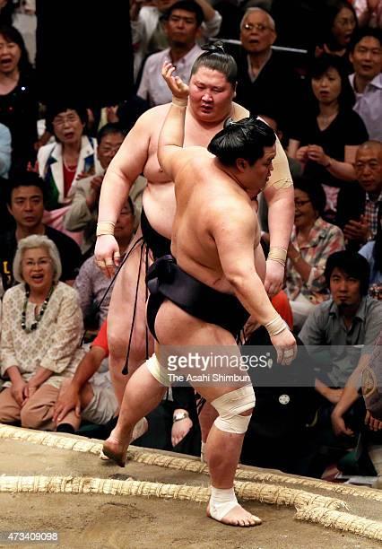 Myogiryu pushes out Mongolian wrestler Ichinojo to win in day six of the Grand Sumo Summer Tournament at Ryogoku Kokugikan on May 15 2015 in Tokyo...