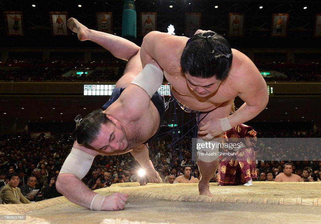 Myogiryu (R) throws Georgian wrestler Tochinoshin, whose real name is Levan Gorgadze to win during day 12 of the Grand Sumo New Year Tournament at Ryogoku Kokugikan on January 24, 2013 in Tokyo, Japan.