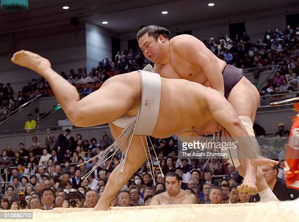 Myogiryu throws Mongolian wrestler Takanoiwa to win during day four of the Grand Sumo Spring Tournament at the Edion Arena Osaka on March 16 2016 in...
