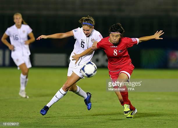 Myong Hwa Jon of Korea DPR and Morgan Brian of USA battle for the ball during the FIFA U20 Women's World Cup Japan 2012 Quarter Final match between...