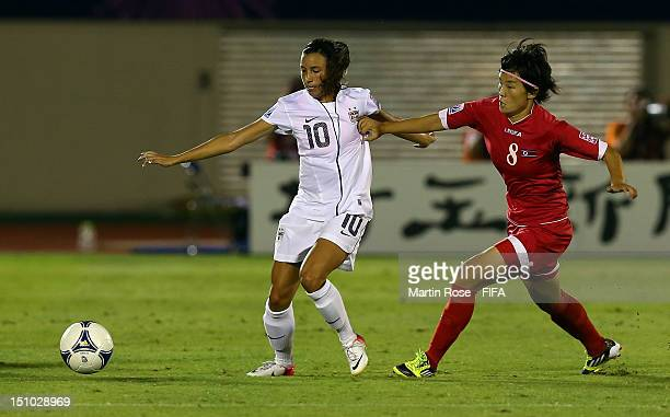 Myong Hwa Jon of Korea DPR and Vanessa Di Bernardo of USA battle for the ball during the FIFA U20 Women's World Cup Japan 2012 Quarter Final match...