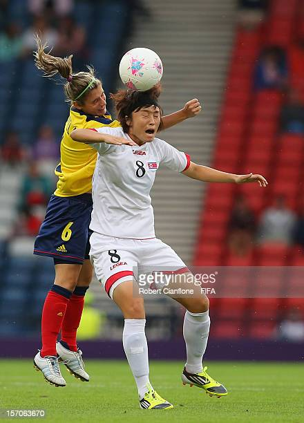 Myong Hwa Jon of Korea DPR is challenged by Daniela Montoya of Colombia during the Women's Football first round Group G Match of the London 2012...