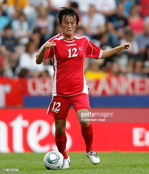 Myong Hwa Jon of Korea runs with the ball during the FIFA Women's World Cup 2011 Group C match between North Korea and Sweden at FIFA World Cup...