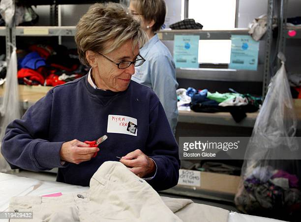 Myra Kraft and other wives of the New England Patriots organization participated in Cradles to Crayons program in Quincy The wives sorted clothing...