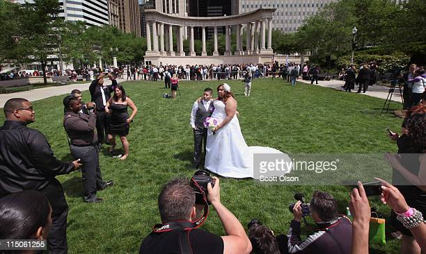Myra Rodriguez and Janeida Rivera pose for pictures after exchanging vows in a Civil Union ceremony in Millennium Park June 2 2011 in Chicago...