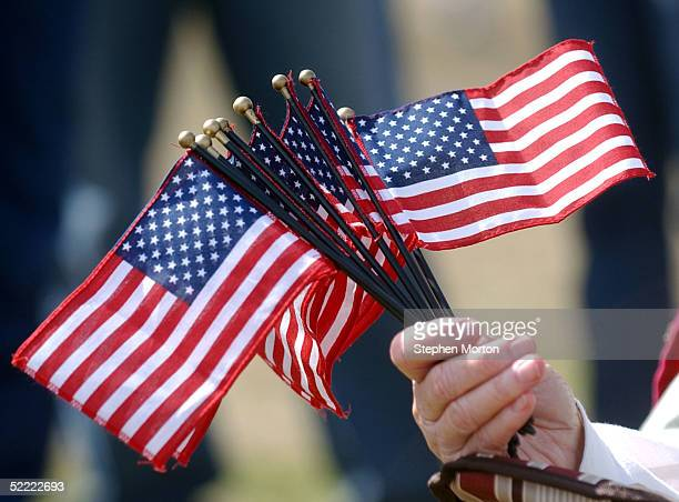 Myra Waldroop holds a fist full of flags February 20 2005 during a homecoming celebration for 150 soldiers from the Army's 3rd Infantry Division...
