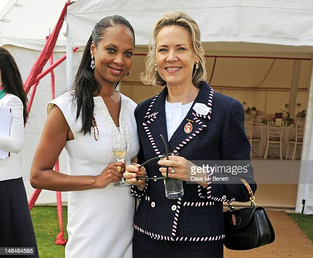 Myrella Moses and Carla Bamberger attend the Cartier Queen's Cup Polo Day 2012 at Guards Polo Club on June 17 2012 in Egham England