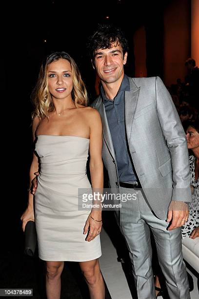 Myriam Catania and Luca Argentero attend the Gucci Spring/Summer 2011 fashion show during Milan Fashion Week on September 22 2010 in Milan Italy