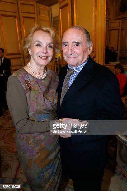 Myriam Colombi and Claude Brasseur attend Claude Brasseur is elevated to the rank of Officier de la Legion d'Honneur at Elysee Palace on March 13...