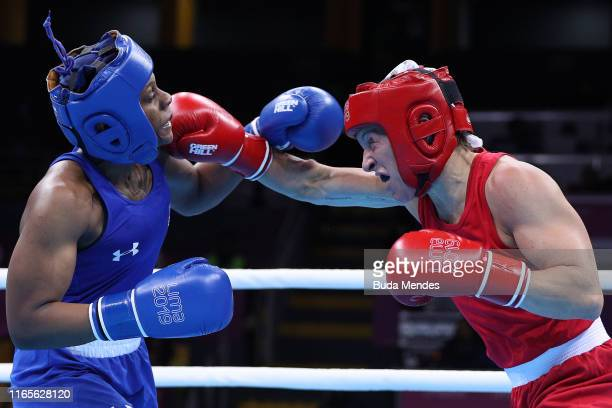 Myriam Da Silva of Canada and Oshae Jones of United States compete in during Boxing Women's Welter Final Bout on Day 6 of Lima 2019 Pan American...