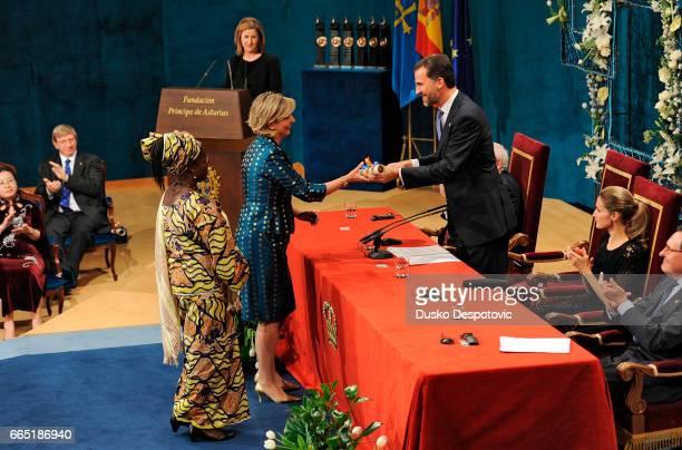 Myriam G. Abrisqueta and Cécile Samagui, representatives of Manos Unidas, 2010 Prince of Asturias Awards laureate for Concord, are presented with the...
