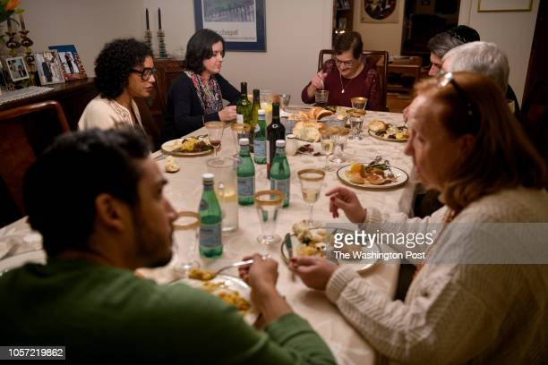 Myriam Gumerman center enjoys the company of her friends as they gather to celebrate the Shabbat at her home on Friday November 2 2018 in...