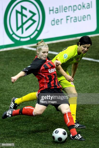 Myriam Krueger of SC Freiburg 1904 in action against Christina Graf of SC 07 Bad Neuenahr during the THome DFB Indoor Cup at the Boerdelandhalle on...