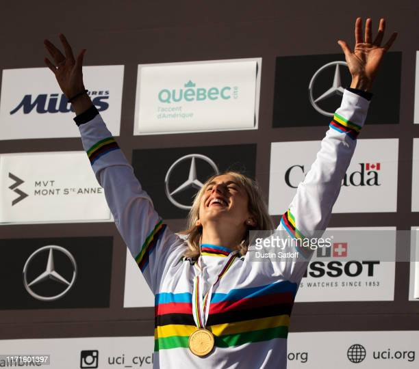 Myriam Nicole of France celebrates on the podium after winning the women's Downhill final at the UCI Mountain Bike World Championships at...