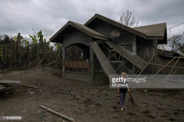 Myriam Rodriguez stands before her ashcovered home which was damaged by the eruption of the nearby Taal volcano in Buso Buso on January 19 2020