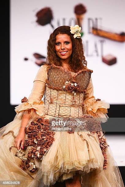 Myriam Seurat walks the runway and wears a chocolate dress made by pastry chef Elodie Martins and fashion brand Mademoiselle P during the Fashion...