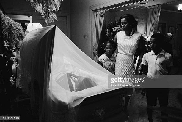 Myrlie Evers and two of her children Rena and Darrell view the body of Medgar Evers at a Jackson funeral home