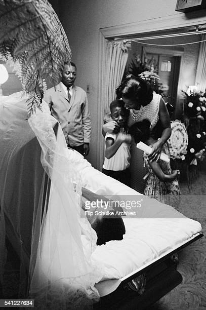 Myrlie Evers and two of her children Rena and Darrell view the body of Medgar Evers at a Jackson funeral home Published in 'He Had a Dream' 1995