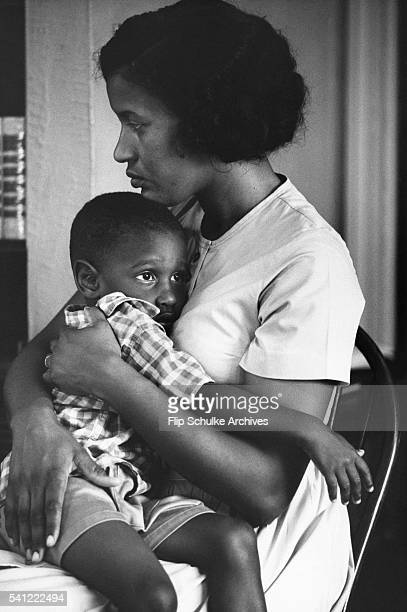Myrlie Evers holds her young son James Van Dyke the morning after her husband civil rights leader Medgar Evers was killed