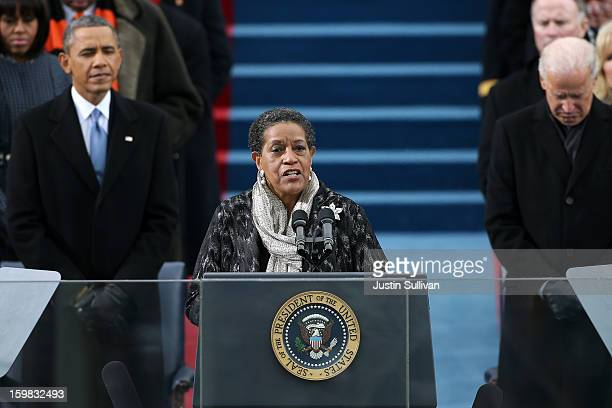 Myrlie EversWilliams gives the invocation as US President Barack Obama and US Vice President Joe Biden look on during the presidential inauguration...