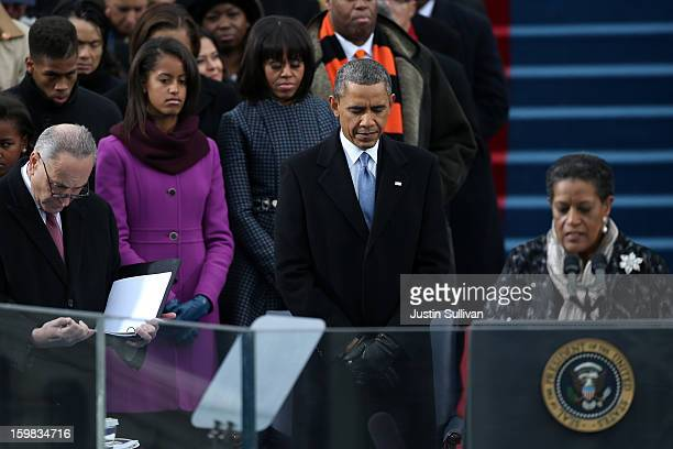 Myrlie EversWilliams gives the invocation as US President Barack Obama looks on during the presidential inauguration on the West Front of the US...