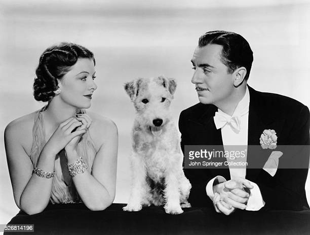 Myrna Loy and William Powell stars of the Thin Man series sit alongside the canine actor Asta