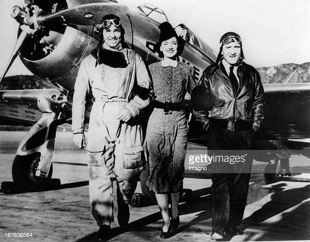 Myrna Loy Clark Gable and Spencer Tracy play together in the movie TEST PILOT The photo shows them after a flight over Hollywood California USA...