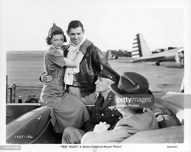 Myrna Loy holding onto Clark Gable in a scene from the film 'Test Pilot' 1938