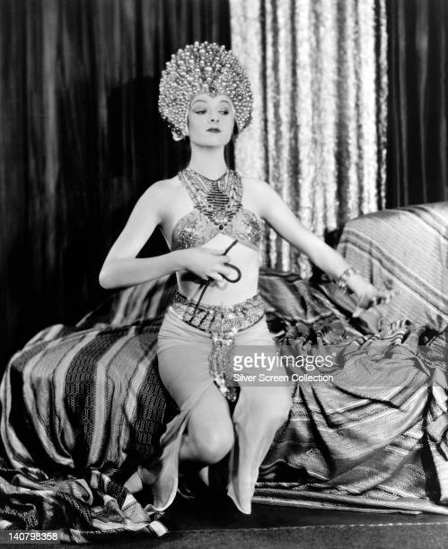 Myrna Loy US actress in costume wearing an elaborate headdress in a studio portrait circa 1930