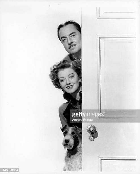Myrna Loy William Powell and dog publicity portrait for the film 'The Thin Man Goes Home' 1945