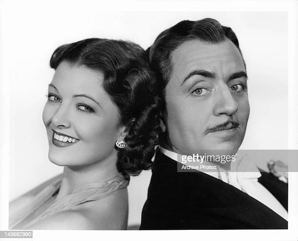 Myrna Loy William Powell back to back in a scene from the film 'After The Thin Man' 1936