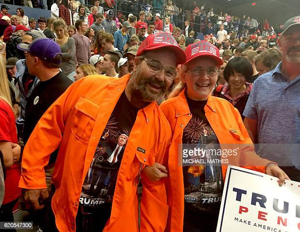 Myron and Marsha Anderson two laid off drywall finishers attend a rally for Republican presidential nominee Donald Trump in Eau Claire Wisconsin on...
