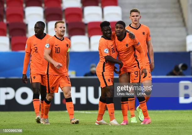 Myron Boadu of Netherlands celebrates with team mates after scoring their side's second goal during the 2021 UEFA European Under-21 Championship...