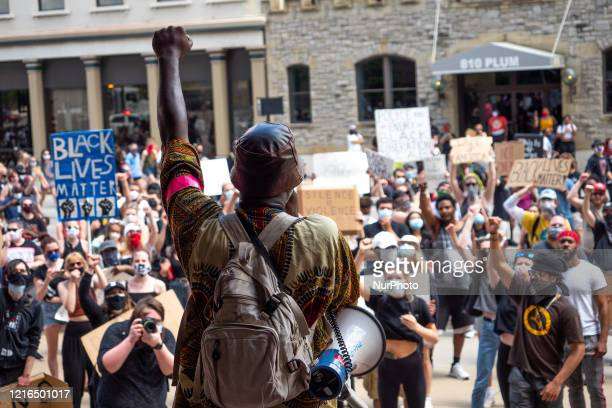 Myron Hollister Haynes speaks to protesters during a Mass Action for Black Liberation protest and march from Washington Park to City Hall following...