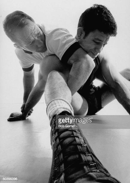Myron Roderick head coach at Oklahoma State Univ demonstrating banana split hold