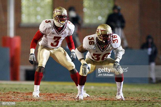 Myron Rolle and Dekoda Watson of the Florida State Seminoles defend against the Maryland Terrapins on November 22 2008 at Byrd Stadium in College...