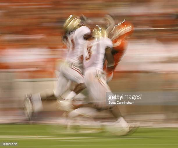 Myron Rolle and Patrick Robinsin of the Florida State Seminoles defend a pass against the Clemson Tigers at Clemson Memorial Stadium on September 3...