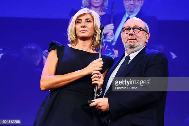 Myrta Merlino and Pierluigi Battista attend the 14th Afrodite Award dinner gala at Studios on January 13 2016 in Rome Italy