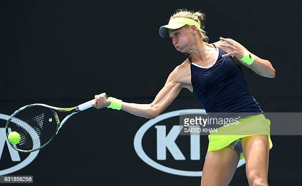 Myrtille Georges of France hits a return against Alizé Cornet of France during their women's singles match on day two of the Australian Open tennis...