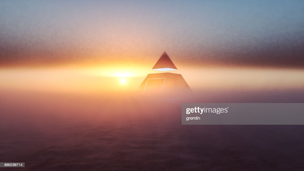 Mysterious alien pyramid in the desert at sunset : Stock Photo