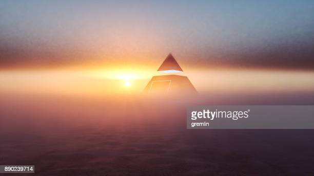 mysterious alien pyramid in the desert at sunset - conspiracy stock pictures, royalty-free photos & images