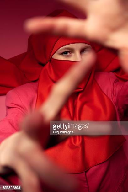 mysterious dance of woman in niqab - cliqueimages stock pictures, royalty-free photos & images