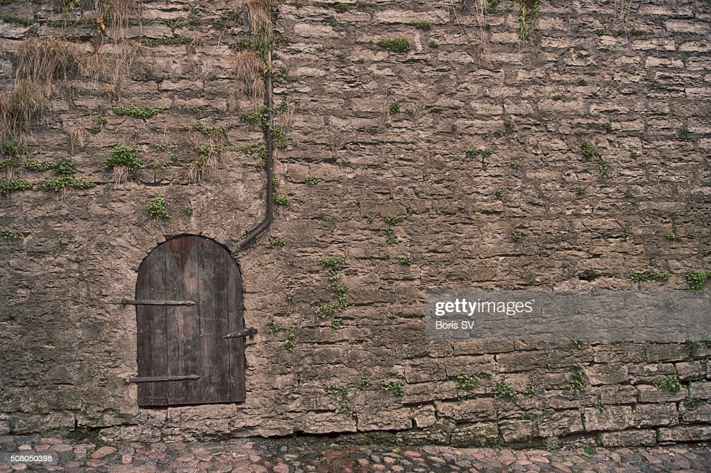 Mysterious door in the old castle  Stock Photo & Mysterious Door In The Old Castle Stock Photo | Getty Images