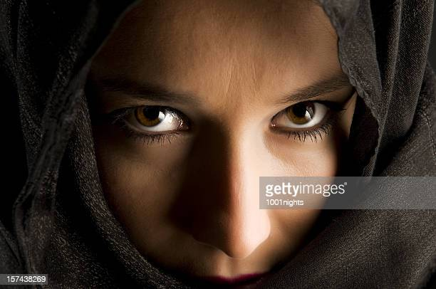 mysterious eyes - iranian woman stock photos and pictures