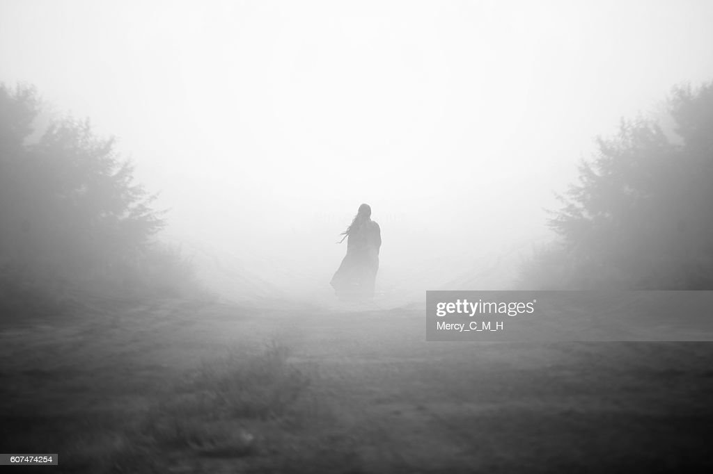 Mysterious girl in the fog black and white