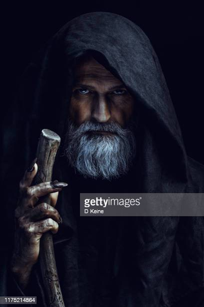 mysterious hooded man - monster fictional character stock pictures, royalty-free photos & images