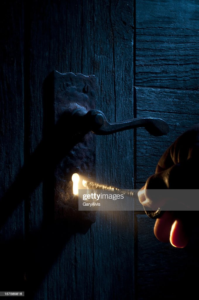 Mysterious Lock and key-light coming through keyhole : Stock Photo