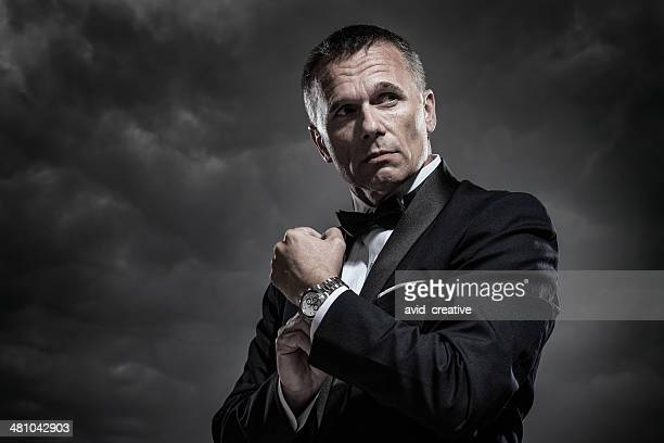 mysterious man in tuxedo - dj stock pictures, royalty-free photos & images