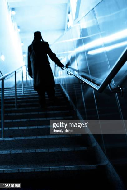 mysterious man on stairs